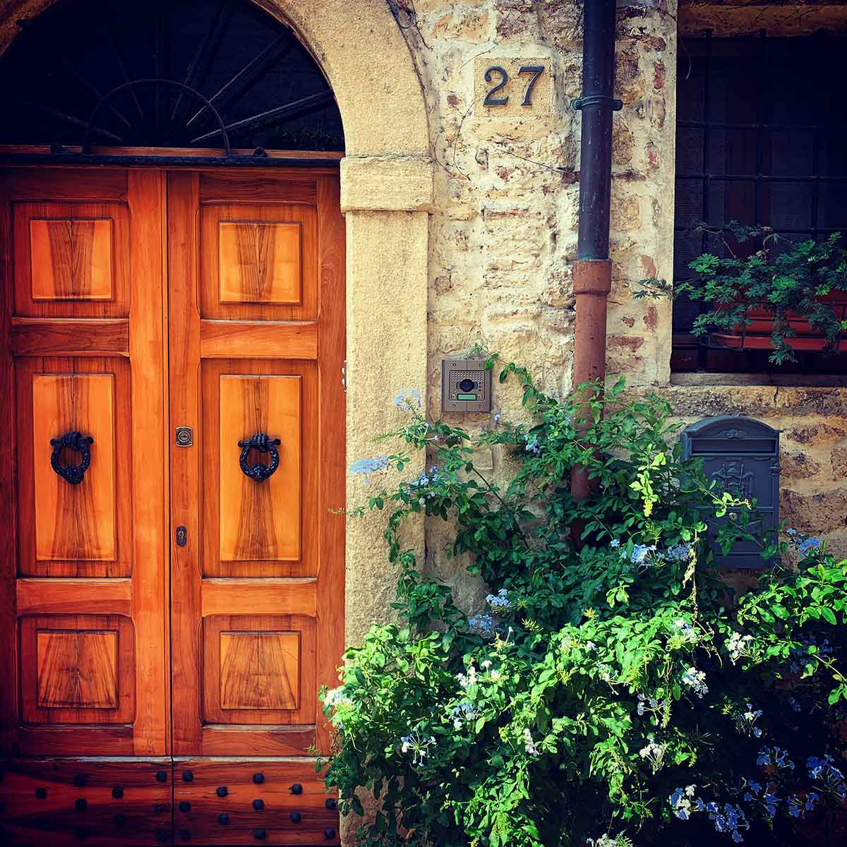 Colorful flowers and pretty door in San Marino
