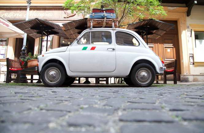 Mini car with luggage for Tips for Driving in Italy hero image