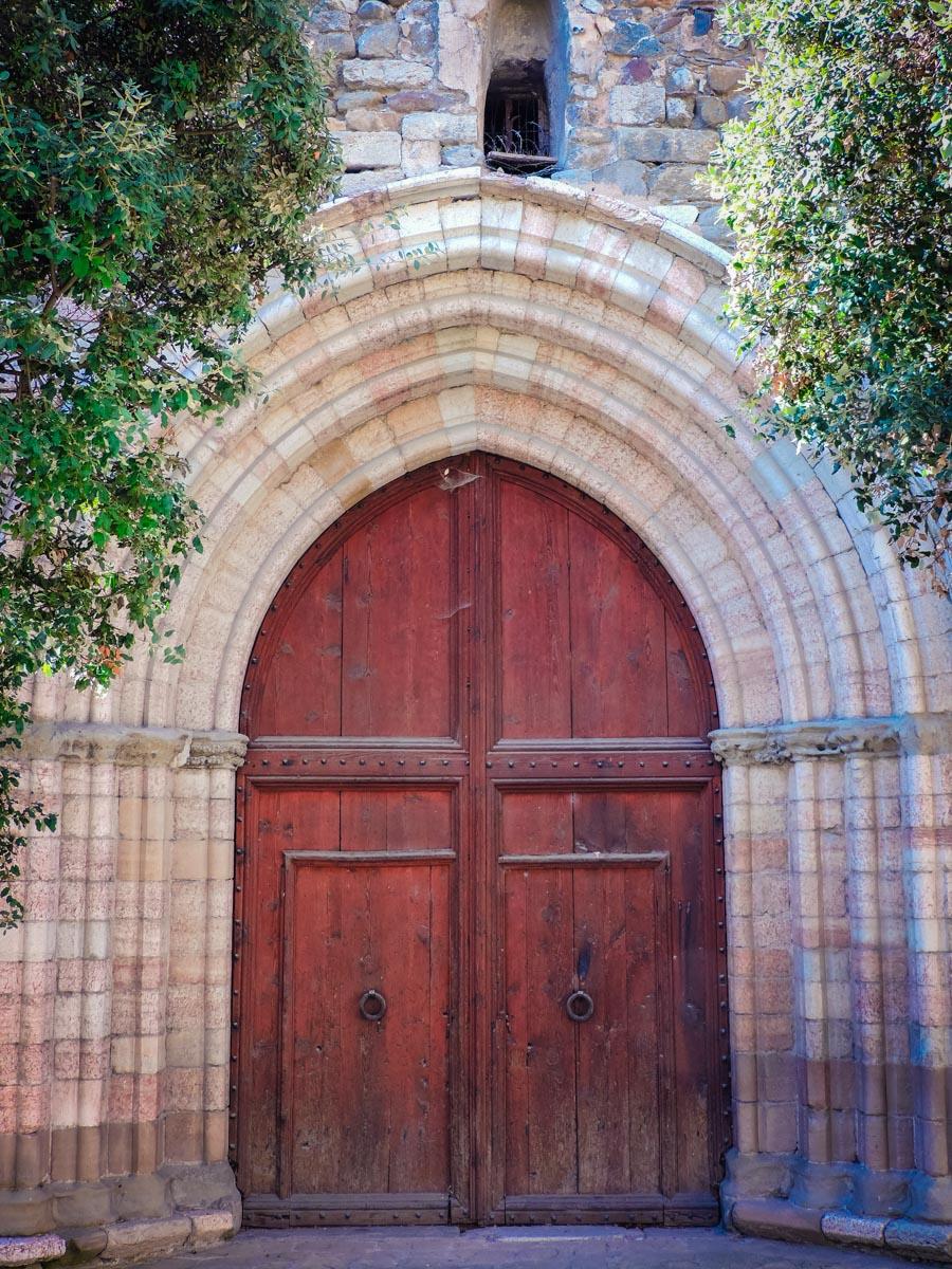 Church doors in Baga, Spain