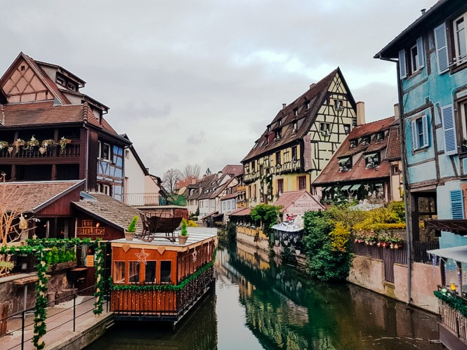 The German-influenced houses on a canal in Colmar, one of the best cities in France to visit