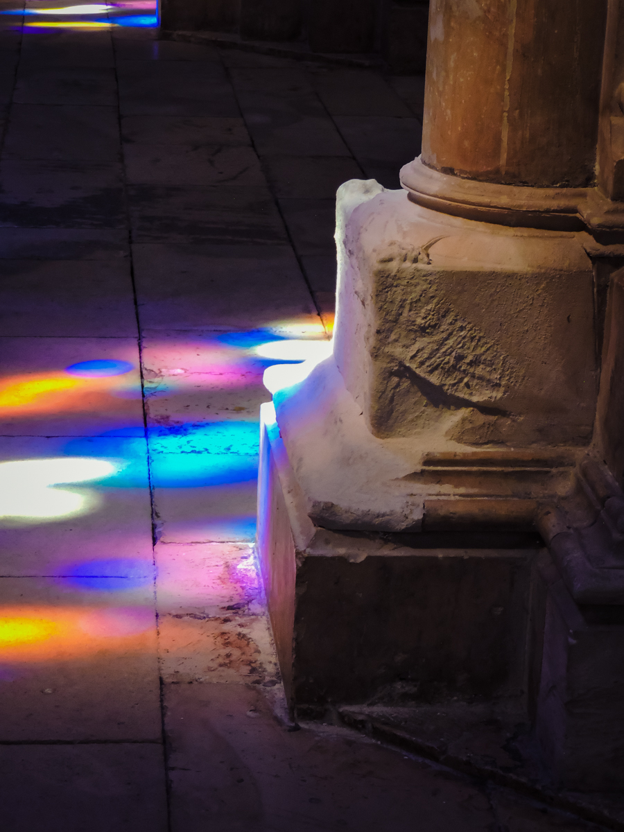 Stained glass reflecting on the floor of the Batalha Cathedral