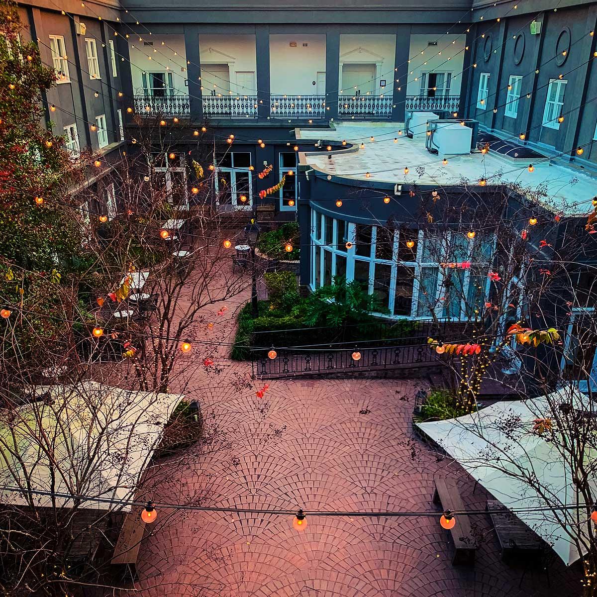 Fairy lights criss-crossing the Kimpton Brice Hotel courtyard