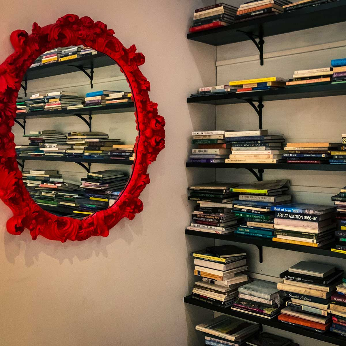 Cool red mirror and books at the Kimpton Brice Hotel