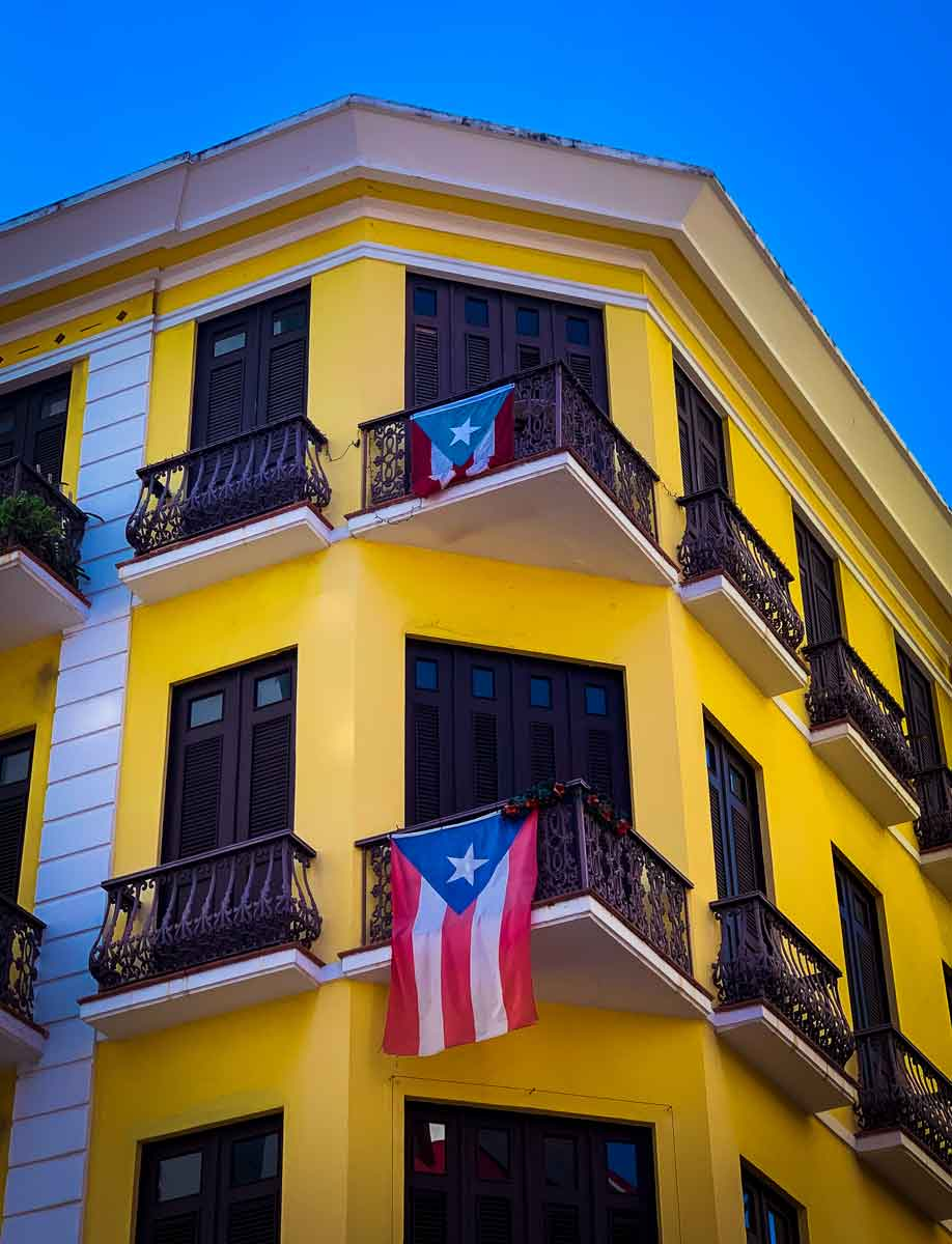 yellow building with puerto rican flags