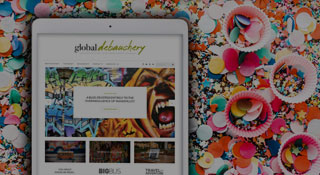 iPad with Global Debauchery site sitting on top of colorful confetti