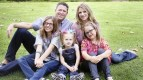 From left to right: Rick and Cristy Spooner with daughters Cali, 14, Ryann, 3, and Raelyn, 7 (Courtesy Mindy Land Photography / February 28, 2013).
