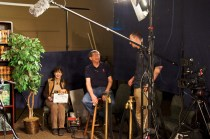 Jane waits while Gary chats with guest to set