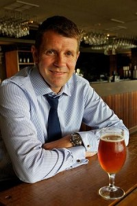 Premier Mike Baird enjoys a beer at either the right time of the day or while playing the pokies.