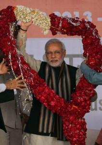 Narendra Modi, then chief minister of Gujarat,  in Ahmadabad, India, Saturday, Dec. 28, 2013. (AP Photo/Ajit Solanki)