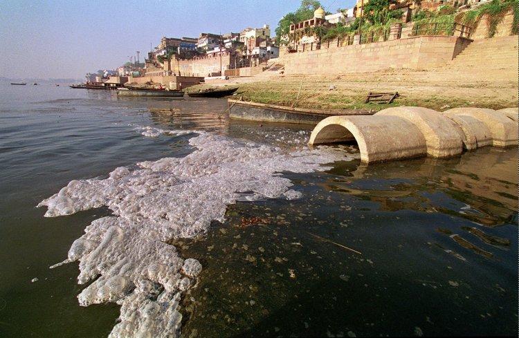 Raw sewage flows into the Ganges River, April 7, 1998 at Varanasi. India. (AP Photo/John McConnico)