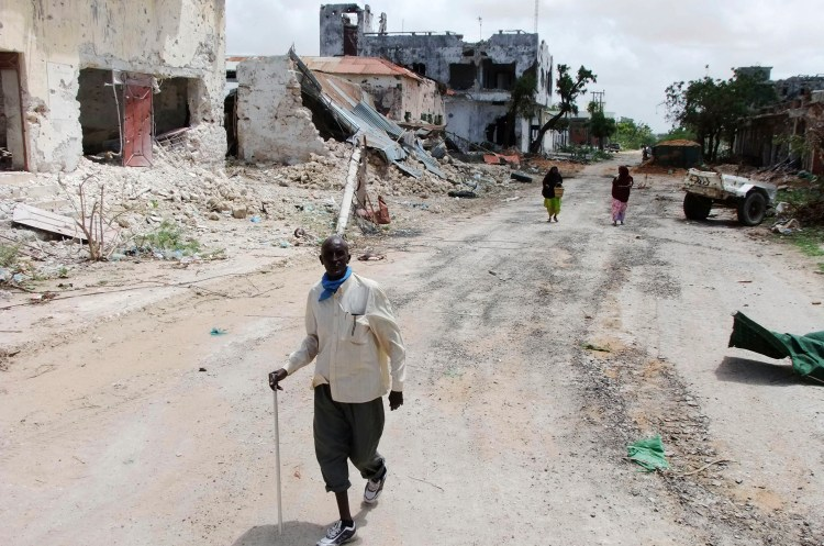 Civilians walk along a street in Mogadishu, Somalia, Aug, 7, 2011. (AP Photo/ Farah Abdi Warsameh)