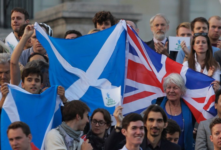 Supporters of keeping Scotland in the U.K. wave flags in 2014. Should the U.K. vote to leave the EU it might trigger a new Scottish independence vote. (AP Photo/Lefteris Pitarakis)
