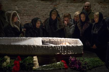 The killing of opposition leader Nemtsov, whose body is pictured above during a service in 2015, convinced Orlova to flee. (AP Photo/Pavel Golovkin)