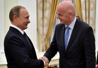 Russian President Vladimir Putin shakes hands with FIFA President Gianni Infantino  April 20, 2016. (Alexander Nemenov/via AP)