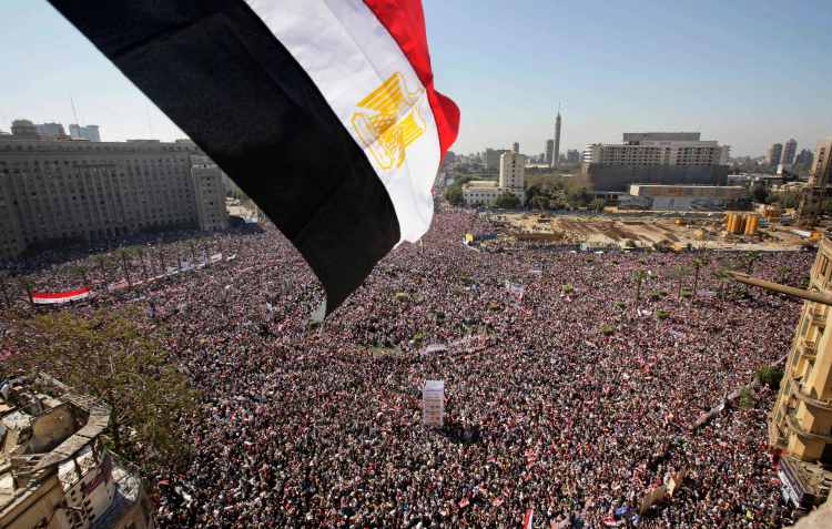Tens of thousands of Egyptians celebrate thh fall of President Hosni Mubarak, Feb. 18, 2011. The Arab Spring brought hope to LGBT activists in the country. (AP Photo/Ben Curtis)