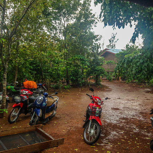 motorbikes rain mud farm rural laos