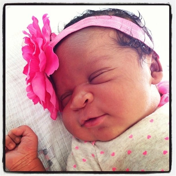 newborn bi-racial baby girl with pink bow