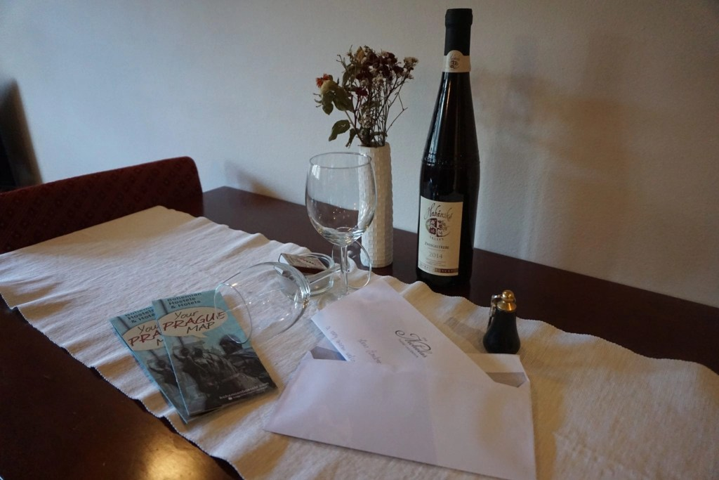 Personalized note and complimentary bottle of wine for guests at The Nicholas Hotel Residence in Prague | A review by Global Munchkins