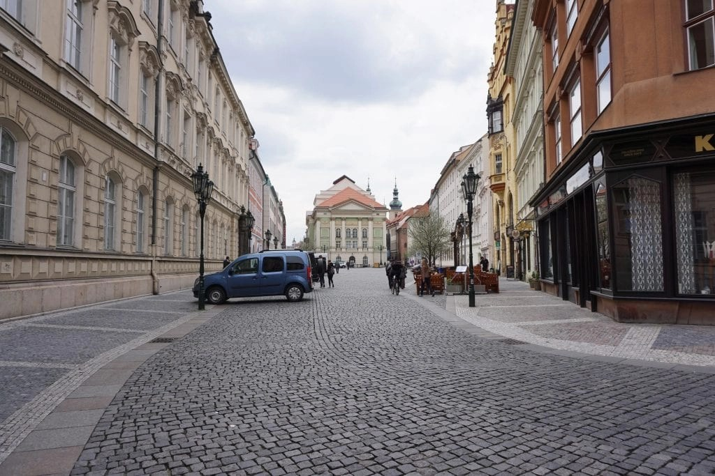 Gorgeous cobblestone street in Prague, at end is the theater Mozart played in. Global Munchkins