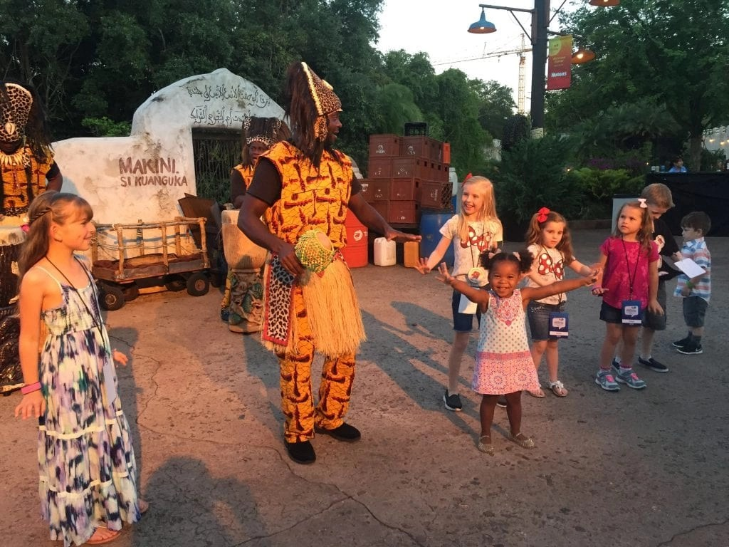 Cute baby dancing with performer at Animal Kingdom | Global Munchkins