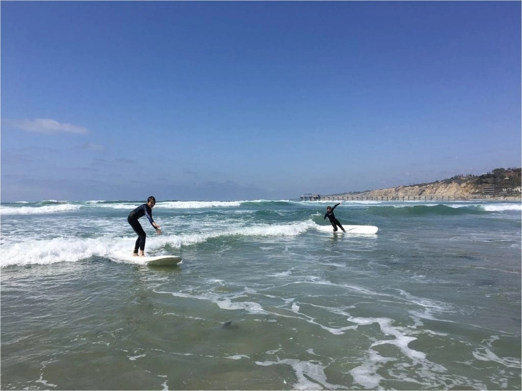 Boys surfing in California THE LEO LOVES San Diego Lifestyle Family Photographer Erin Oveis Brant