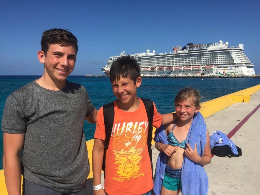 Family in front of Norwegian Getaway in Costa Maya