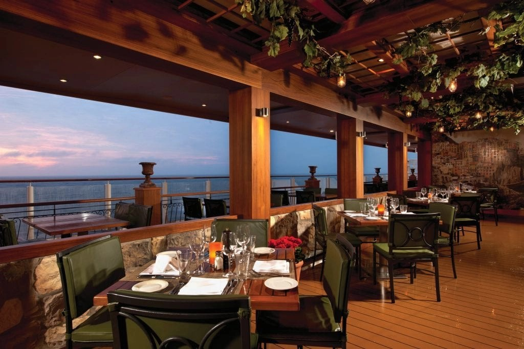 La Cucina restaurant with indoor and outdoor seating along the waterfront on the Norwegian Getaway