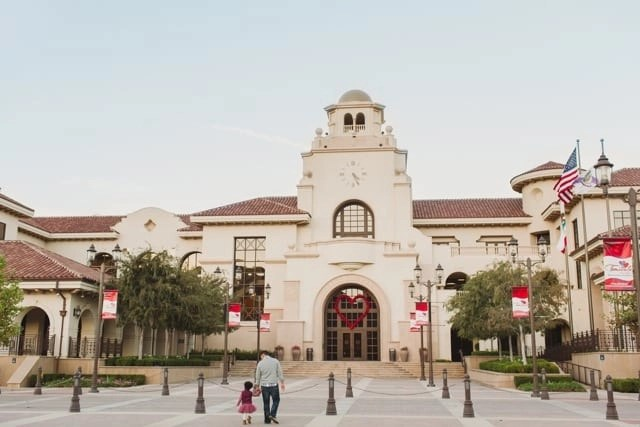 Bi racial daughter and adoptive white father in front of a beautiful city hall building in Temecula CA