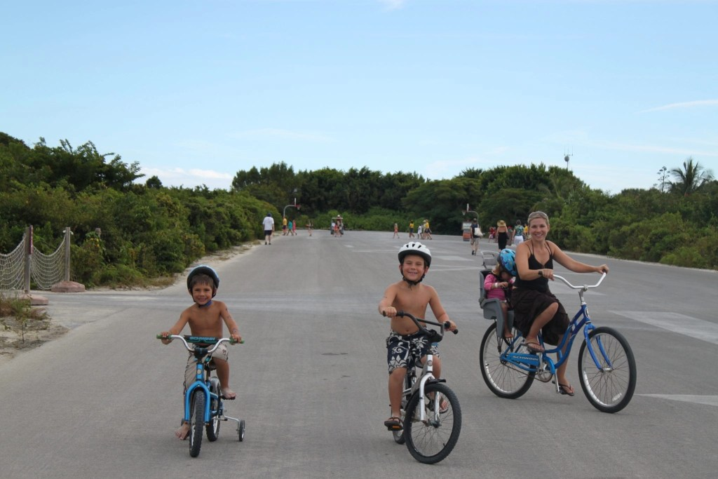 Family bike riding on Disney's Castaway cay | Global Munchkins