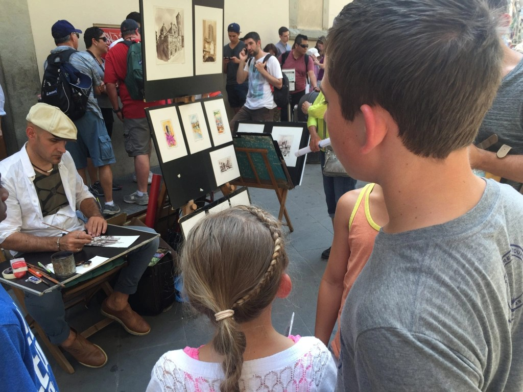 Kids checking out the street art while in Italy. Things to do in Rome with Kids | Global Munchkins