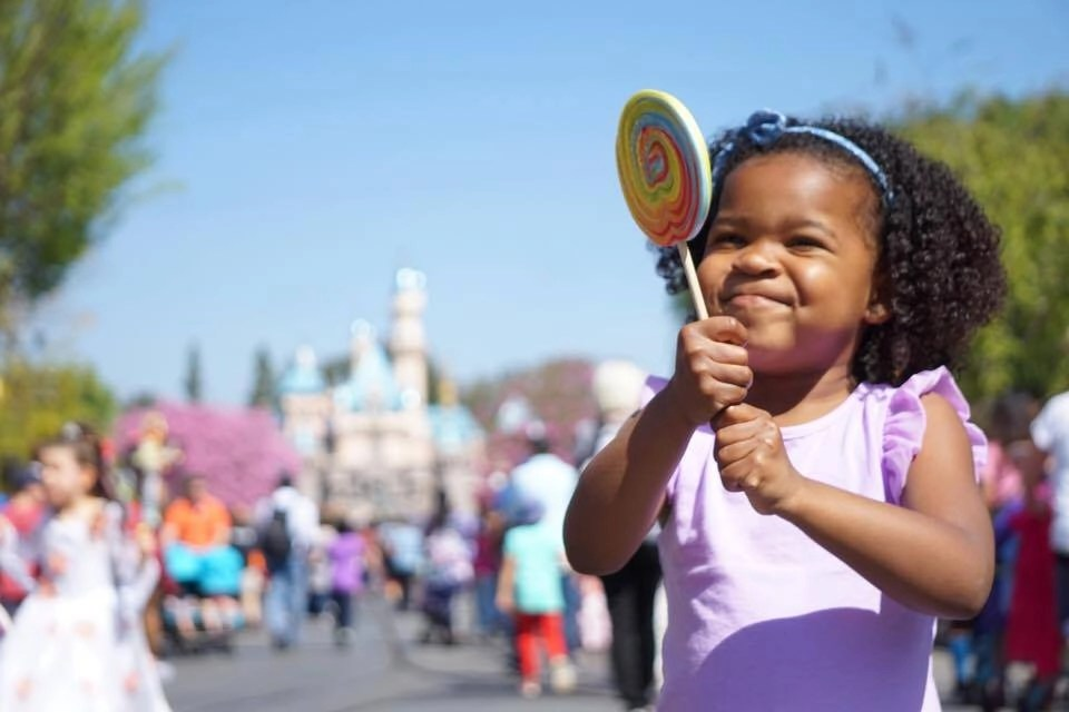Girl with Lollipop at Disneyland