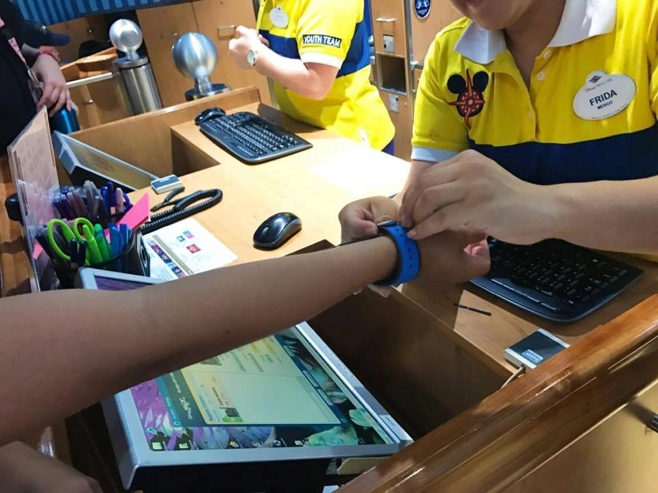 Getting magic band for Oceaneer's Club onboard the Disney Magic. Disney Cruise Line
