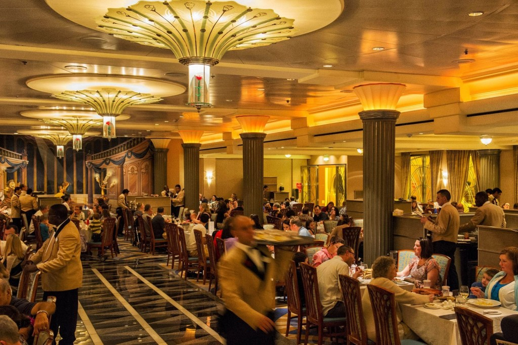 """Lumiere's on the Disney Magic resembles a grand dining room aboard a classic transatlantic ocean liner. The design features rose-petal chandeliers and theming from Disney's """"Beauty and the Beast,"""" adding a little French flair and providing a magical night of dining and romance. (Matt Stroshane, photographer)"""