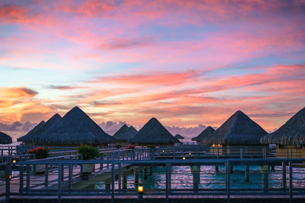 Gorgeous luxury resorts. Polynesian sunset.