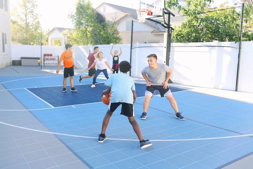 We are obsessed with our new outdoor basketball court from Sport Court. It's actually a Multi-Game court so when we are done with basketball we still have six more sports to choose from to play. It's incredible!!!