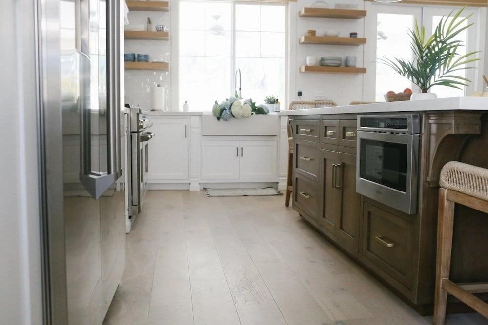 coastal kitchen featuring BLANCO PROFINA farmhouse sink and BLANCO CULINA faucet