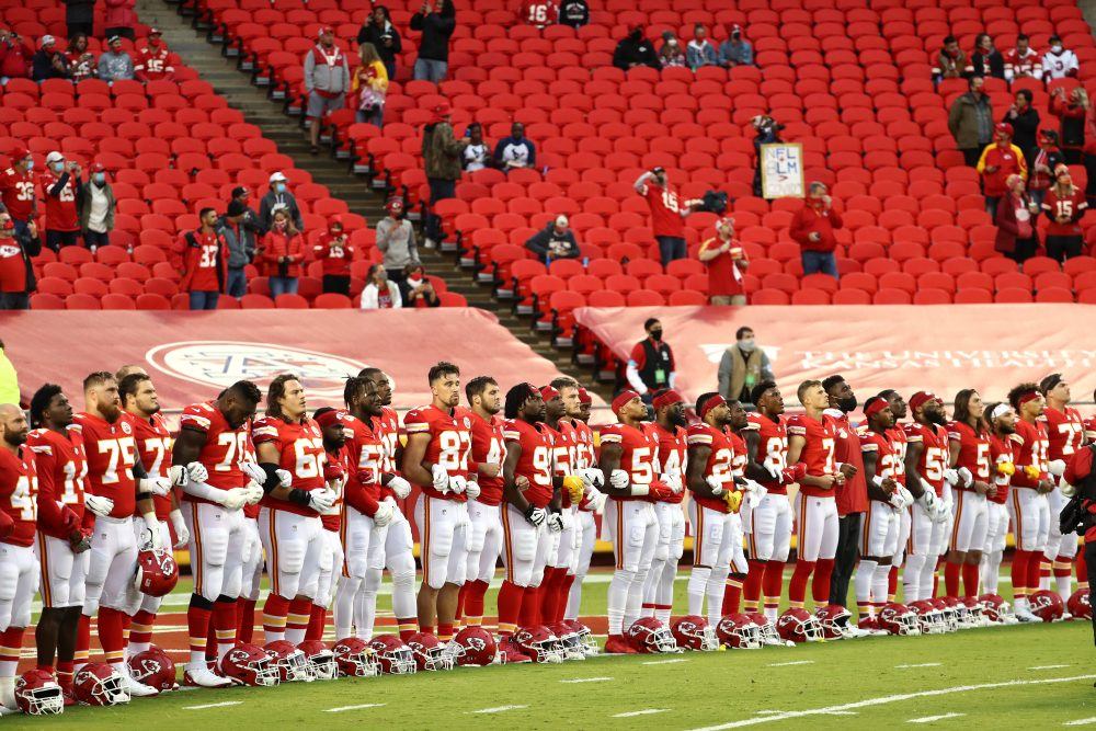 Members of the Kansas City Chiefs stand united for with locked arms before the start of a gam against the Houston Texans at Arrowhead Stadium on September 10, 2020 in Kansas City, Missouri.