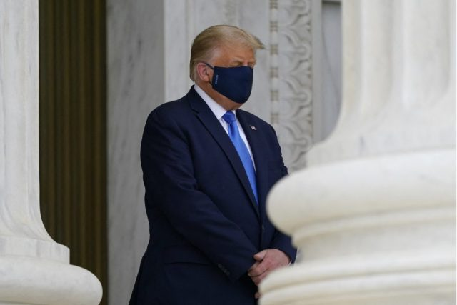 U.S. President Donald Trump pays respects as Justice Ruth Bader Ginsburg lies in repose under the Portico at the top of the front steps of the U.S. Supreme Court building on Thursday, Sept. 24 2020, in Washington.
