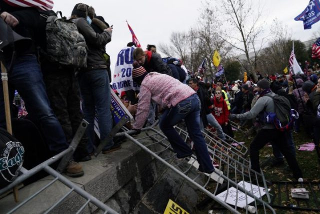 Pro-Trump protesters storm the grounds of the US Capitol, in Washington, DC, USA, 06 January 2021. Various groups of Trump supporters have broken into the US Capitol and rioted as Congress prepares to meet and certify the results of the 2020 US Presidential election.