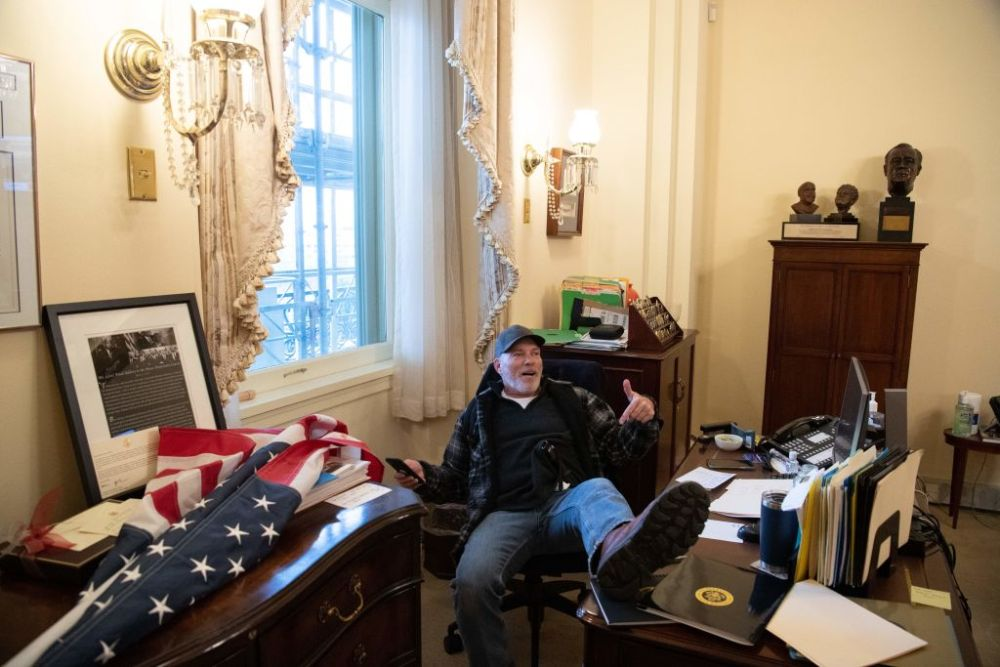 Richard Barnett, a supporter of U.S. President Donald Trump, sits inside the office of U.S. Speaker of the House Nancy Pelosi as he protests inside the U.S. Capitol in Washington, D.C. on Jan. 6, 2021.
