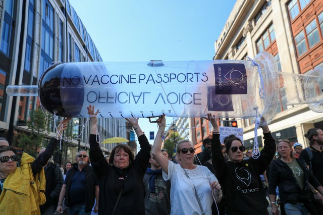 Protesters march in London, U.K., on April 24, 2021 against vaccine passports, face masks and lockdown. The U.K. government aims to provide official proof of vaccination for millions of British holidaymakers this summer starting as early as May 17.
