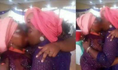 Nigerians react as two women shares deep kiss at a wedding ceremony (photos)