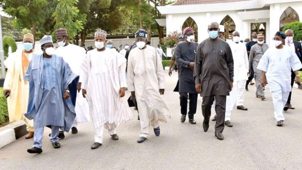 Nigerians react to Tinubu's meeting with APC governors over party tussle in Edo state