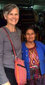 Dianne Henke stands next to a woman in Guatemala