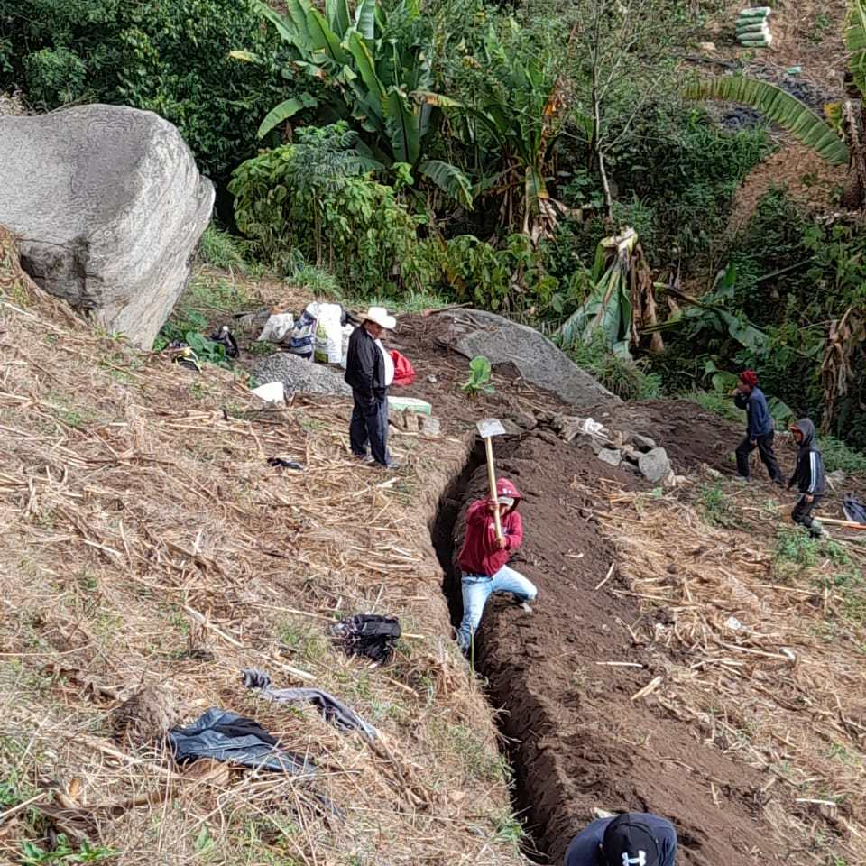 The crew digs trenches for the Las Joyas water project.