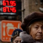 Russia cuts interest rates as rouble crisis eases