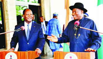 President Goodluck Jonathan (right), with the visiting President Alassane Ouattara of Cote d'Ivoire in Abuja on Monday
