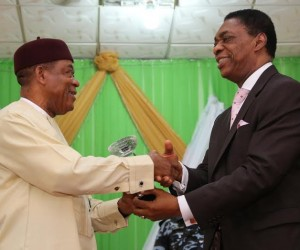 state Governor, Theodore Orji receiving an award as > ''Epitome of Equity and Justice'' from Prof. Herbert Orji, Chairman, National Broadcasting Commission > on-behalf of ASOPADEC as they honour the governor in Umuahia.