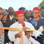 Abia state Governor, Theodore Orji cutting the tape to commission the 1st Phase of Aba shopping mall in Aba