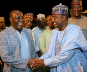 (R-L): Former Vice President Atiku Abubakar in a handshake with Adamwa State, Governor-elect Umar Jibirilla Bindow, when he received the former Vice President on his return from South Africa at the  Nnamdi Azikiwe International Aiport, Abuja, Monday